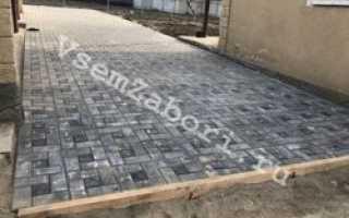 Мощение тротуарной плиткой въезда на участок